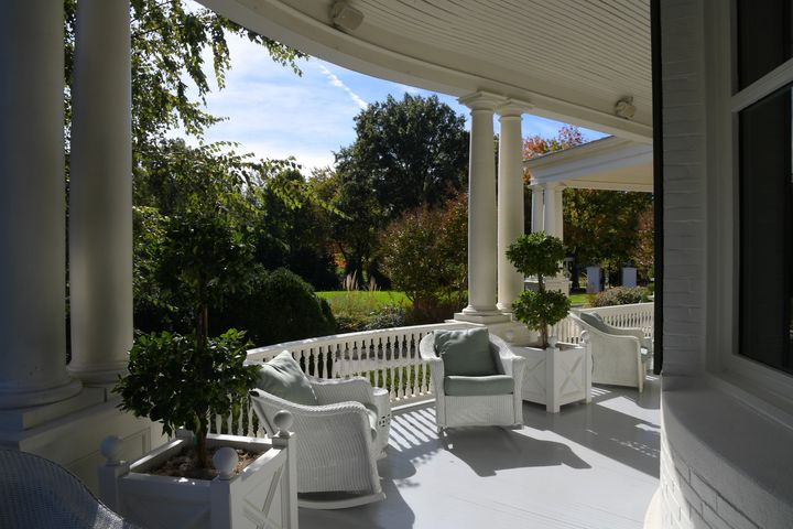 The wraparound porch at the residence in 2016.