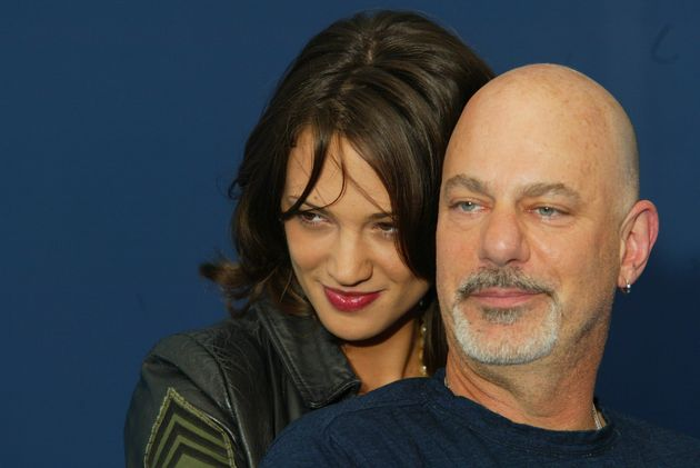 Asia Argento,Rob Cohen (Photo by Stephane Cardinale/Corbis via Getty