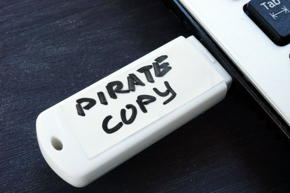 Pirate copy written on a flash drive. Copyright law.