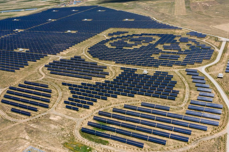 A panda-shaped solar park in Datong, Shanxi, China. China is both a key investor in coal and also a leader in renewables, wit