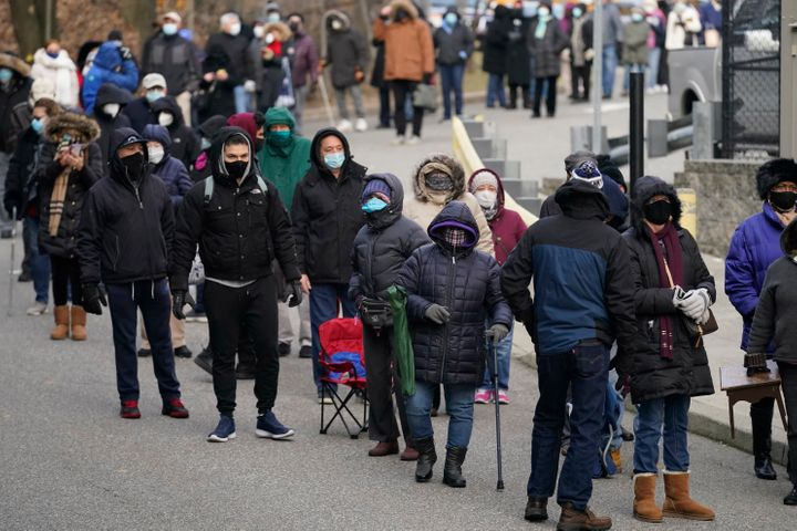 People wait in line for the COVID-19 vaccine in Paterson, N.J., on Jan. 21, 2021. The first people arrived around 2:30 a.m. f