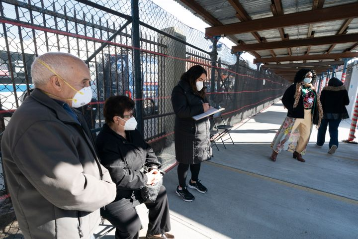 People wait in line to get vaccinated at the Brooklyn Army Terminal, on Jan. 21, 2021, in New York. Officials say 15 New York
