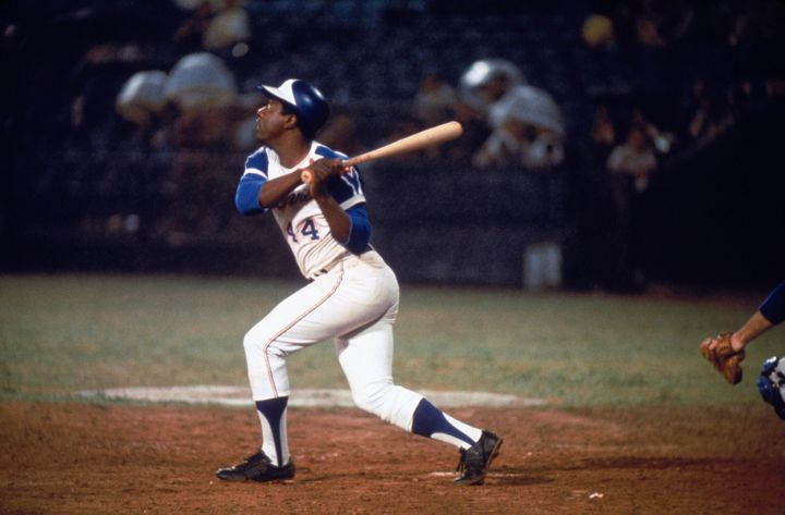 Hall of Famer Hank Aaron of the Atlanta Braves swings at the ball. (Photo by Focus On Sport/Getty Images)