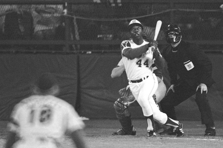Atlanta Braves' Hank Aaron eyes the flight of the ball after hitting his 715th career homer in a game against the Los Angeles