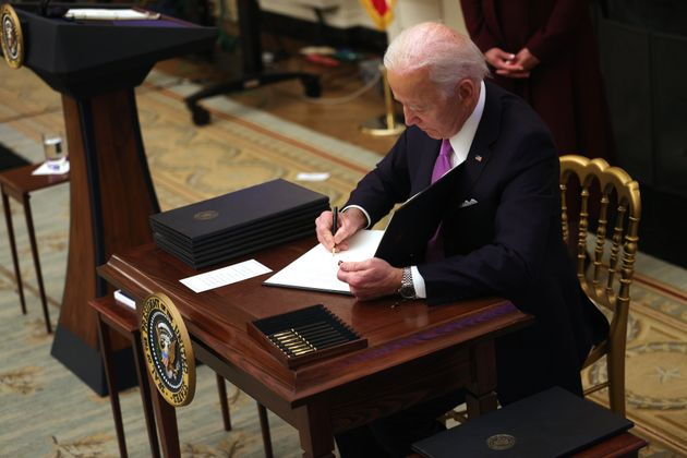 WASHINGTON, DC - JANUARY 21: U.S. President Joe Biden signs an executive order during an event in the...