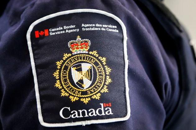 A Canada Border Services Agency patch is seen on an officer in Calgary in