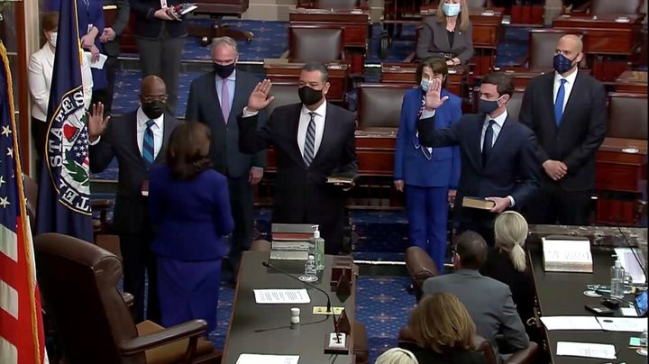 (Left to right) Democrats Raphael Warnock, Alex Padilla and Jon Ossoff take the oath of office administered by Vice President