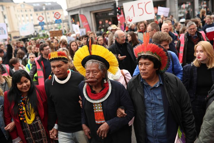 Chief Raoni Metuktire, center front, takes part in a climate march in Brussels on May 17, 2019. The activist has become a sym
