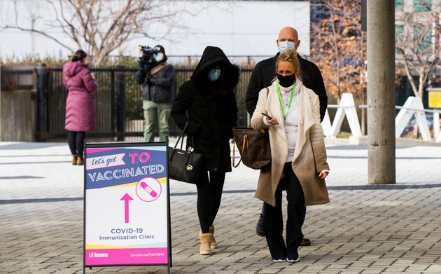 People arrive at a COVID-19 immunization clinic at the Metro Toronto Convention Center MTCC in Toronto...