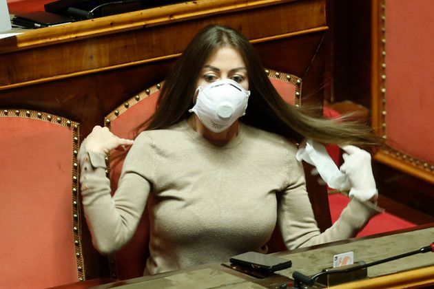 Senator Maria Rosaria Rossi wearing mask and gloves during the sitting in the Senate about the measures...