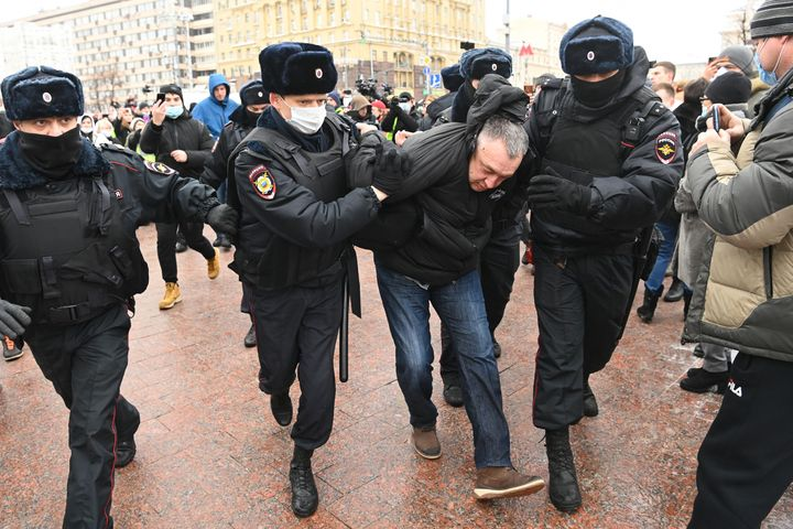 Police detain a man prior to an expected rally in support of jailed opposition leader Alexei Navalny in Moscow on Saturday.
