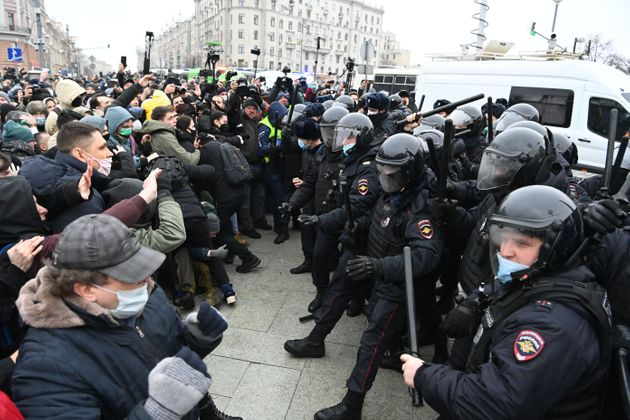 Protesters clash with riot police during a rally in support of jailed opposition leader Alexei Navalny...