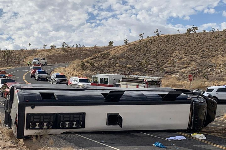 This photo provided by the Mohave County Sheriff's Office shows a Las Vegas-based tour that rolled over in northwestern Arizo