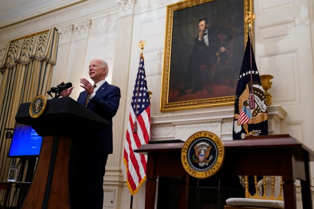President Joe Biden delivers remarks on the economy in the State Dining Room of the White House, Friday,...