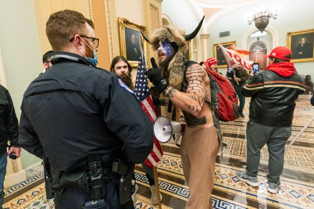 FILE - In this Jan. 6, 2021, file photo supporters of President Donald Trump are confronted by U.S. Capitol...