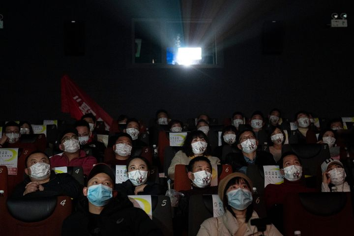 "WUHAN, CHINA - JANUARY 23:(CHIHA OUT)Movie goers wear masks while attending the film ""Days and Nights in Wuhan"" in a cineplex"
