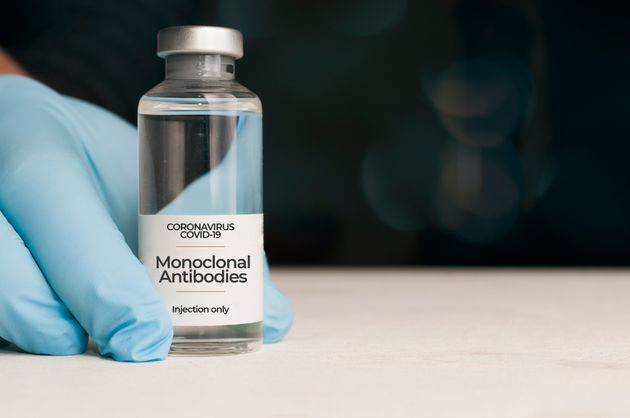 Doctor hold a vial of monoclonal antibodies , a new treatment for coronavirus Covid-19, on a white