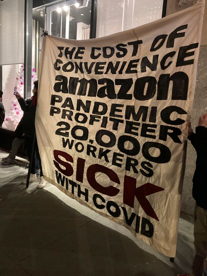 A protest outside of Amazon CEO Jeff Bezos' New York City apartment in December. Since the start of the pandemic, he has made