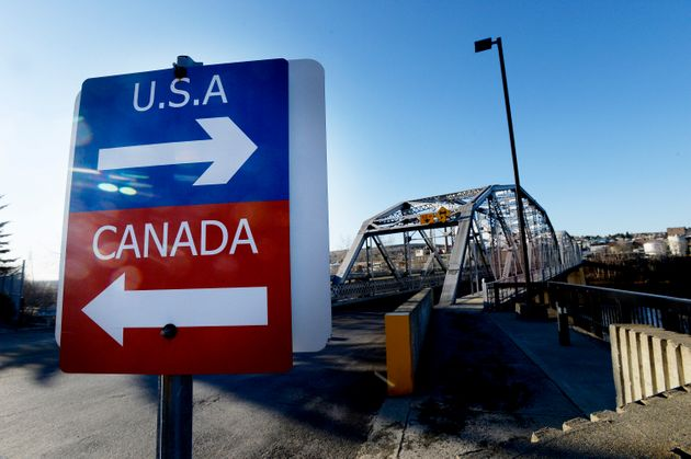 File photo fo a sign pointing to the United States and Canada at the bridge connecting the two countries...