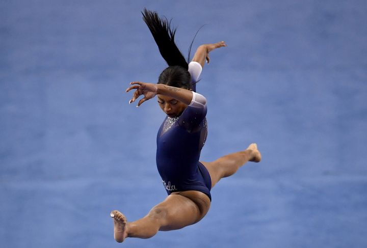 UCLA gymnast Nia Dennis competes in the balance beam against Arizona State on Saturday.