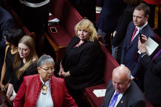 Senator Lynn Beyak waits for the Throne Speech in the Senate chamber in Ottawa on Dec. 5,