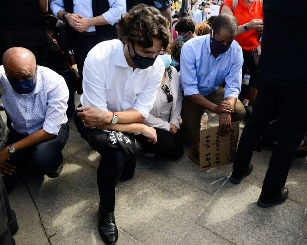 Trudeau takes a knee as he takes part in an anti-racism protest on Parliament Hill in June