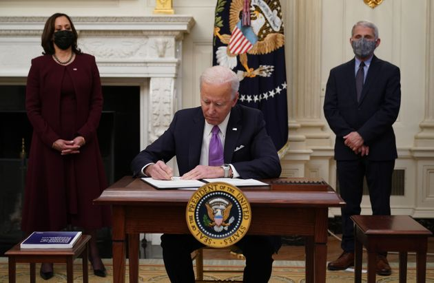 President Joe Biden signs executive orders on January 21 as part of the Covid-19 response as Vice President...