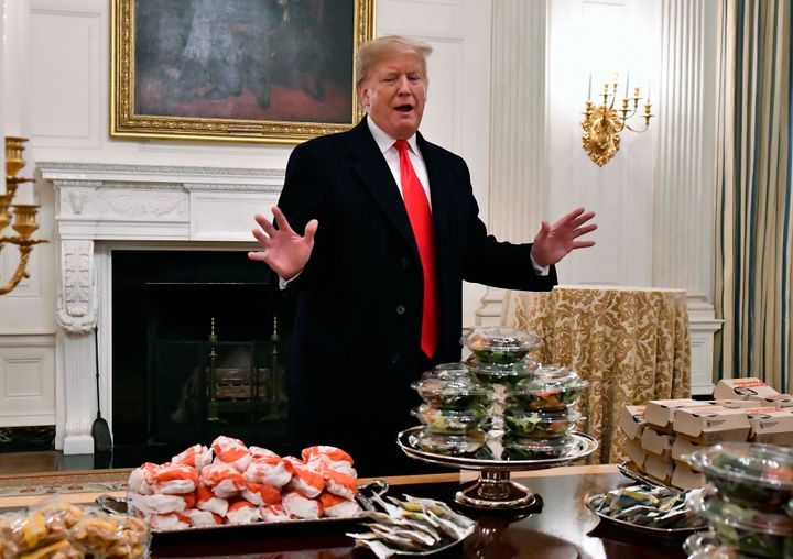 Then-President Donald Trump with a bunch of fast food in January 2019. Trump wanted to make poultry lines run faster even tho