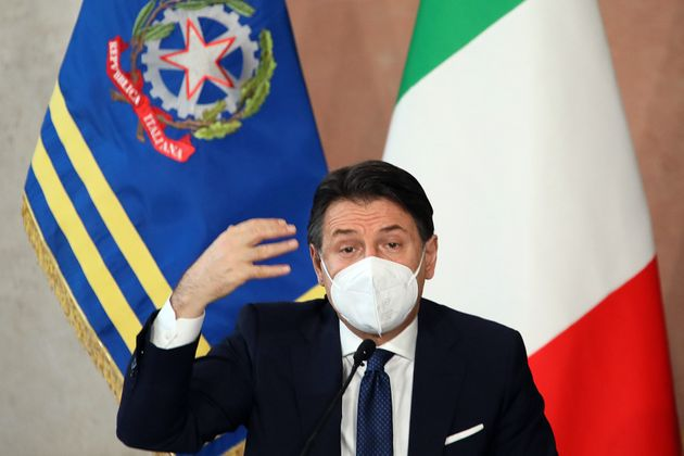 The Italian Premier Giuseppe Conte wearing a face mask during the end of year press conference at Villa...