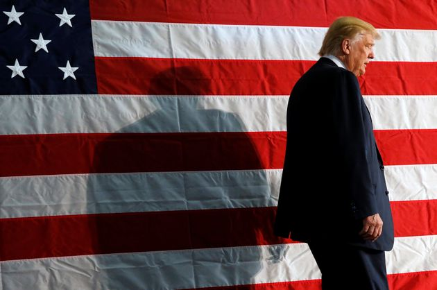 Republican presidential nominee Donald Trump takes the stage for a campaign rally in Colorado Springs,...