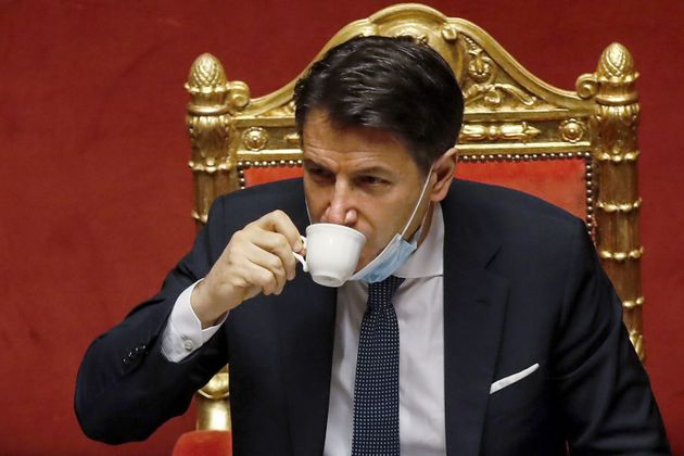 Italian Prime Minister Giuseppe Conte drinks a coffee during a debate prior to a confidence vote at the...