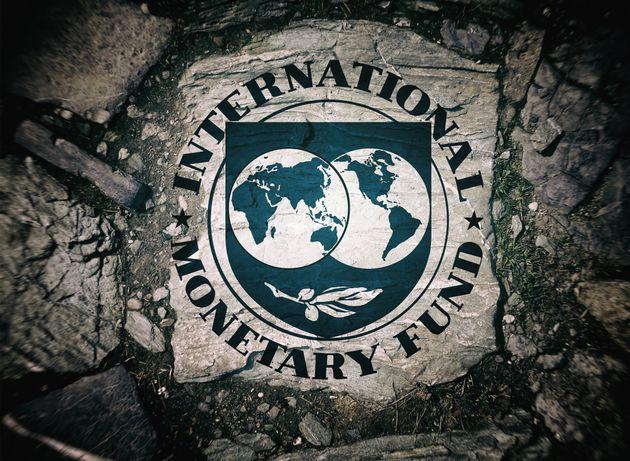 Symbol of the International Monetary Fund, background stone, blurred