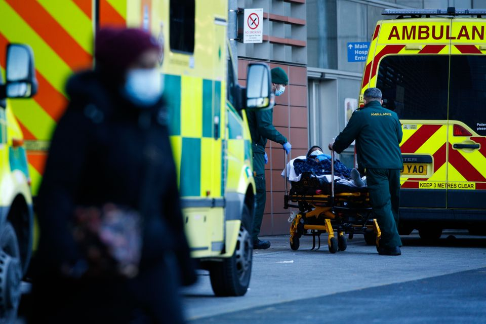 Paramedics wheel a patient into the emergency department of the Royal London Hospital in