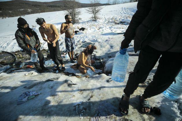 BIHAC, BOSNIA AND HERZEGOVINA - JANUARY 19: Refugees from the Lipa camp take baths on the river on a...