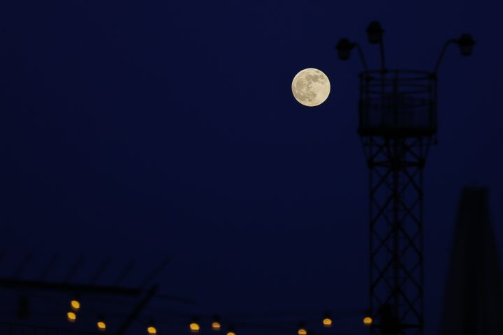 A wolf moon pictured rising over London last January.