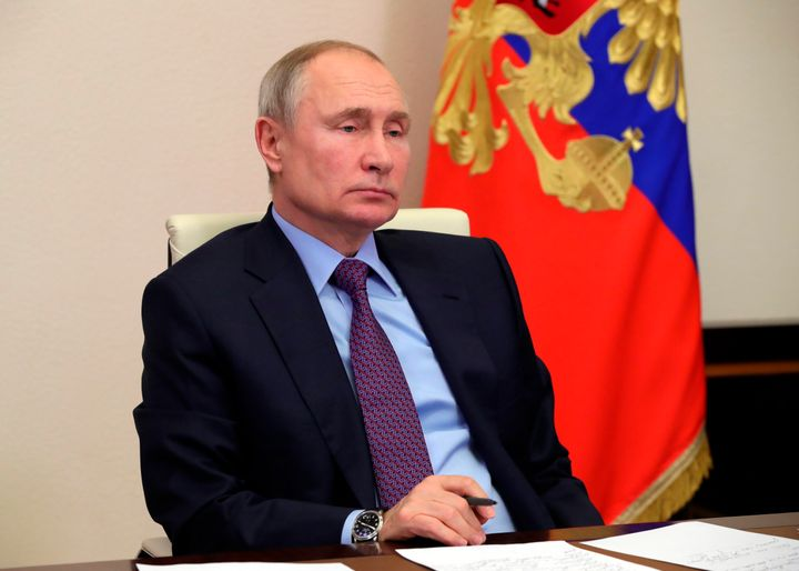 Russian President Vladimir Putin attends a meeting via video conference at the Novo-Ogaryovo residence outside Moscow, Russia