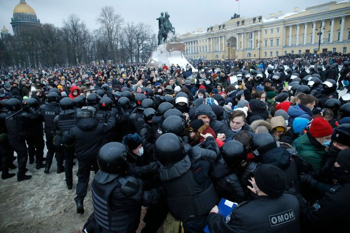 In this Jan. 23, 2021, file photo, people clash with police during a protest against the jailing of opposition leader Alexei