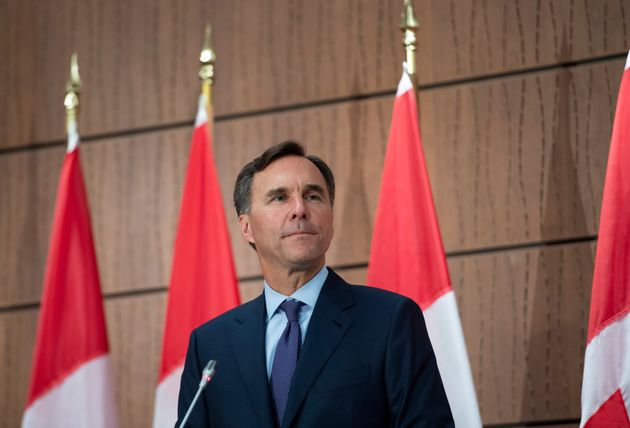 Bill Morneau announces his resignation during a news conference on Parliament Hill in Ottawa on Aug....