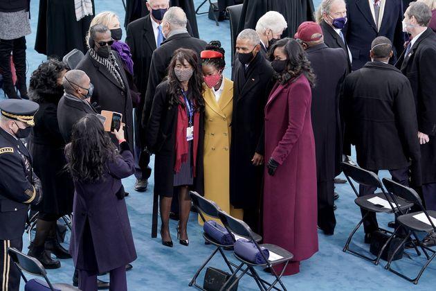 Poet Amanda Gorman (center) with former President Barack Obama and Michelle Obama on Jan. 20.