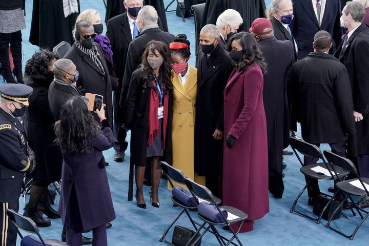 Poet Amanda Gorman (center) with former President Barack Obama and Michelle Obama on Jan. 20.