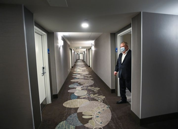 Ontario Premier Doug Ford visits the Holiday Inn Express and Suites, which is used as a COVID-19 isolation hotel during the COVID-19 pandemic in Oshawa, Ont., on Jan. 21, 2021.