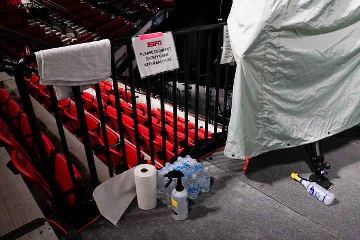Disinfectant spray sits near television cameras inside a basketball arena at ESPN Wide World of Sports Complex Wednesday, Jul