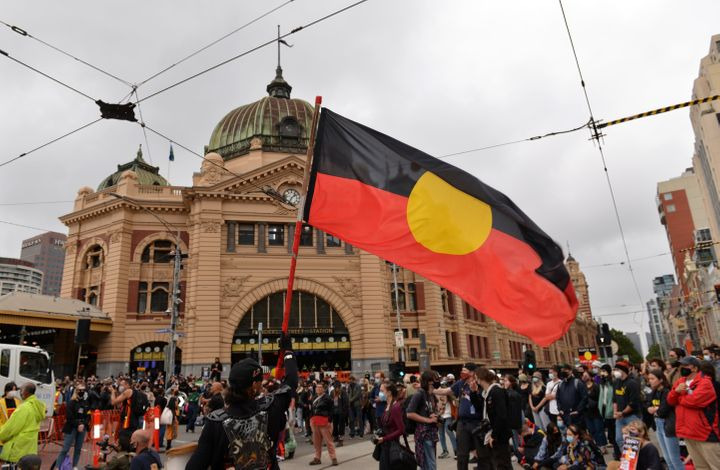 """Aboriginal and Torres Strait Islanders, who opposed the British fleet's arrival on January 26, 1788, to be celebrated as """"Australia Day"""", organise a demonstration describing this date as """"Invasion Day"""" in Melbourne, Australia on January 26, 2021."""