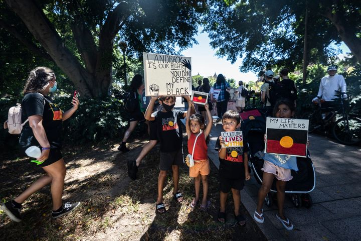 Young protesters in Hyde Park after the 'Invasion Day' Rally on January 26, 2021 in Sydney, Australia.