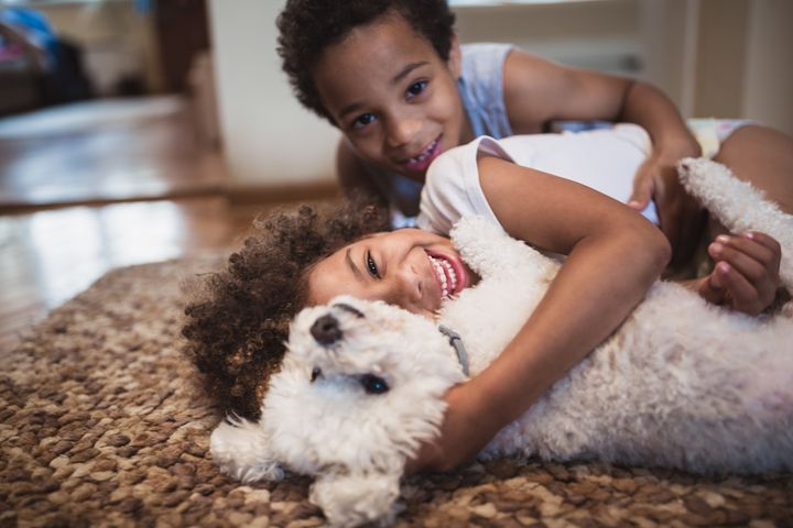 Pets can help kids with emotional management and the development of positive social behaviors.