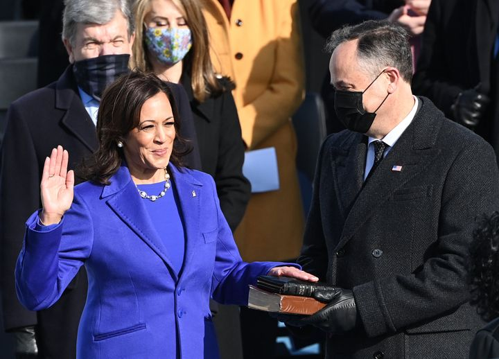 Kamala Harris, flanked by her husband Doug Emhoff, is sworn in as the vice president of the United States on Jan. 20.