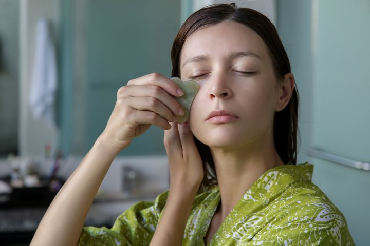 Gua sha facial massage can either be done at home yourself, or professionally at a spa.
