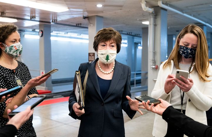 Sen. Susan Collins (R-Maine) speaks with reporters in the Senate subway after a vote in the Capitol on Jan. 26, 2021.
