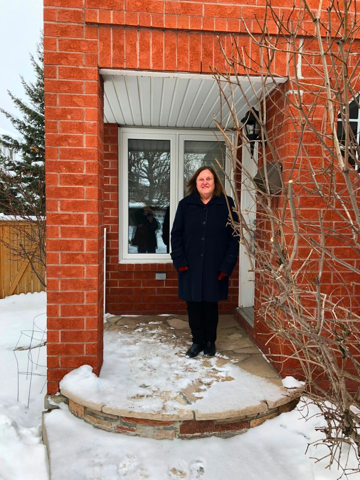 Bonnie Bowering, a supporter of changing her street name from 'Trump Avenue', poses for a photo at her house in a west side suburb in Ottawa on January 26, 2021.