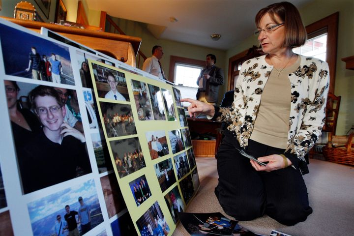 In this Dec. 9, 2011, file photo, Jane Clementi, right, the mother of Tyler Clementi, looks at family photographs in their ho